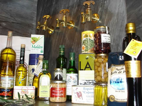 photo of olive oil, olives, asparagus cojonudos, delicious canned food by colmado Múrria Barcelona Spain